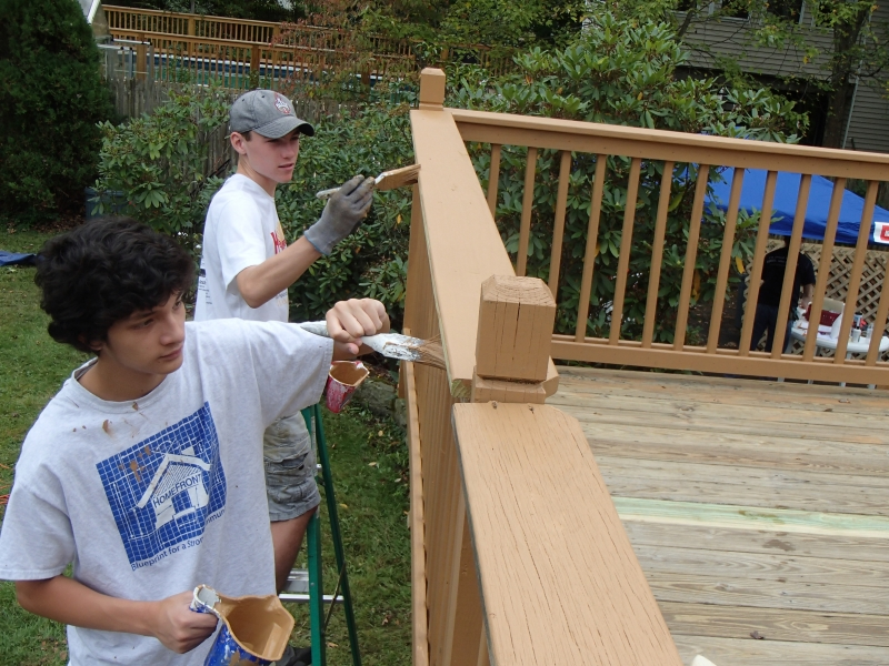 Peter Marsigliano and Jack Fitzpatrick paint deck trim